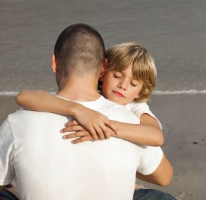 Portrait of a Young Boy Hugging his father